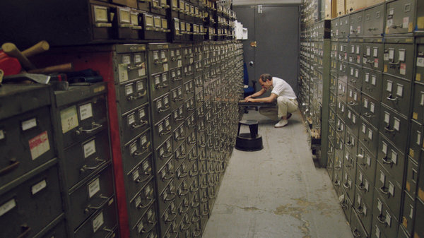 Last remaining archivist Jeff Roth searches the New York Times morgue. Photographer: Ben Wolf